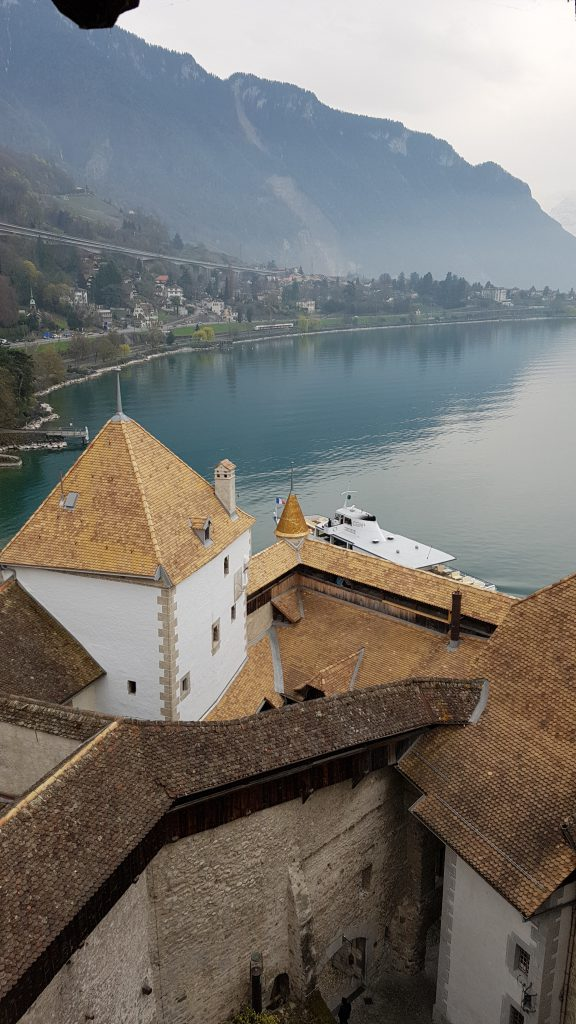 View of the lake from Chillon Castle A CGN boat goes to the port of Chillon Castle.