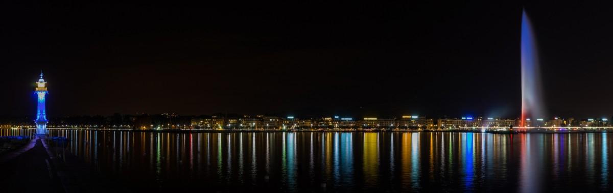 Le jet d'eau de Genève de nuit avec la rade
