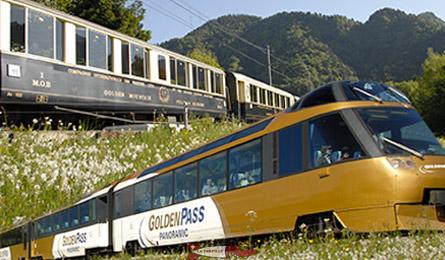 Un ancien train du MOB et le plan récent avec une vue panoramique.