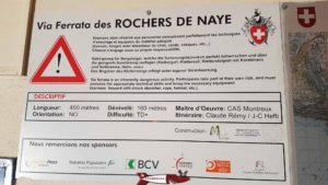 un panneau descriptif sur la via ferrata des rochers de naye dans la gare d'arrivée du train des rochers de naye