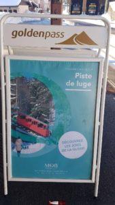 Affiche publicitaire à la gare du MOB des Avants proche de départ du funiculaire Les Avants-Sonloup