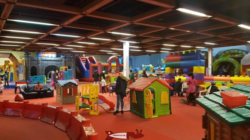 The area containing small houses and bouncy castles.