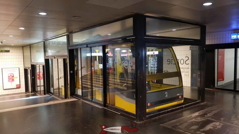 The yellow car of the Fun'ambule funicular at the upper station. The other car is red.