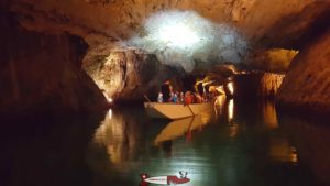 a boat with visitors to the underground lake of Saint-Léonard