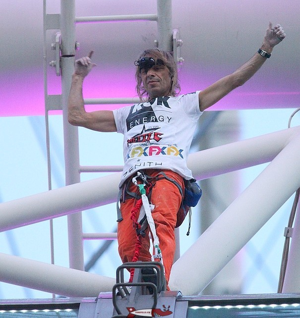 Alain Robert in 2018 with a belay system.
