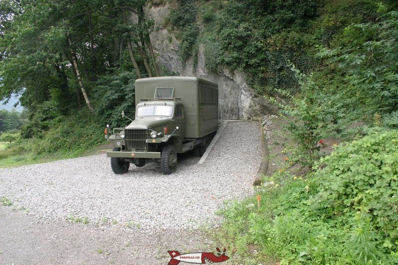 The entrance to the fort of Evionnaz with a military truck used as a ticket office.