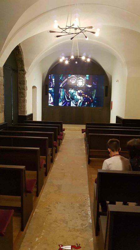 A child:-) watching the film with the audioguide at the abbey of Saint-Maurice
