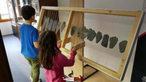 a xylophone built with stones at the museum of earth sciences in martigny