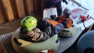 two people launch themselves together on buoys at the leysin tobogganing park
