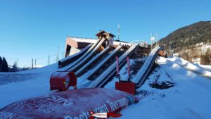 "In the foreground, from left to right, the ""Looping"" and the ""Big Air Bag"" at the leysin tobogganing park"