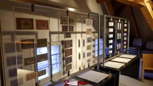 the collection of Swiss franc banknotes on display on the third floor of the Gutenberg Museum in Freiburg