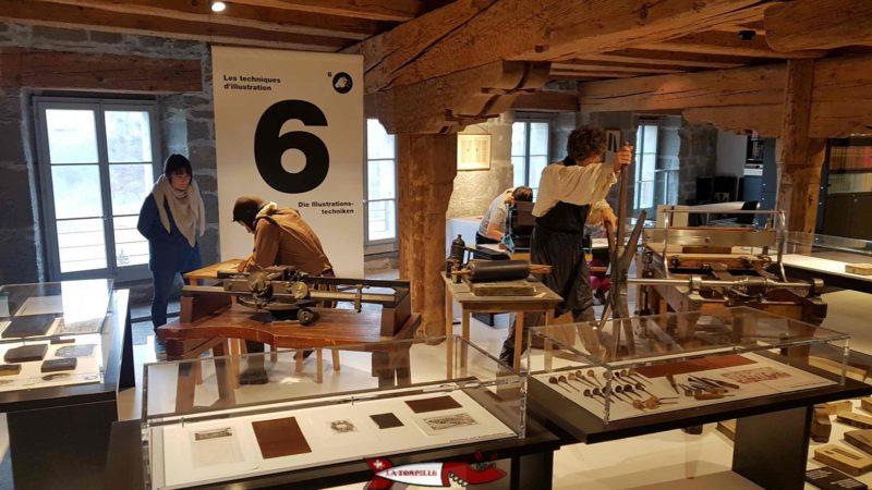 Un poste présentant les techniques d'illustration au 1er étage du musée gutenberg à Fribourg