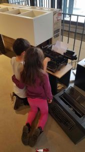 The juniors of the Torpille team are a bit confused in front of a... typewriter at the gutenberg museum in fribourg