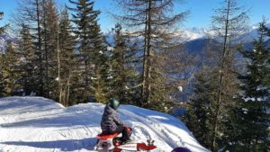 The winter sledge run in Les Marécottes with a view of the Alps.