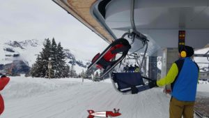 A sled attached to a hook on the chairlift of the gastlosen-Express at jaun