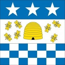 The flag of the city of La Chaux-de-Fonds. It includes a beehive with bees symbolizing freemasonry, 11 small blue squares representing the 11 districts of the town in 1656 and the three 5-pointed stars refer to the celestial vault.