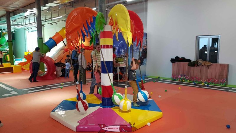 A ball on which a child sits before rotating the structure at Kids Fun Park Etoy
