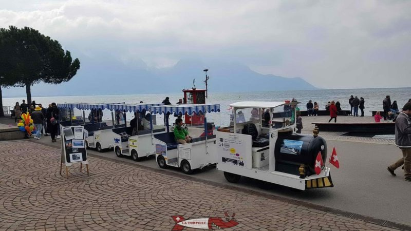 The little train of Montreux at its starting point next to the statue of Freddie Mercury.