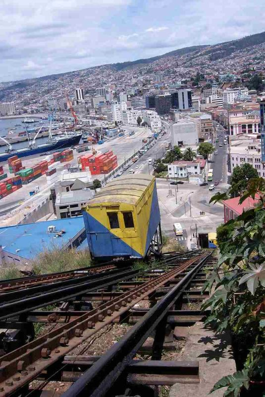 "A funicular called locally ""elevator"" departing from the bay of Valparaiso where the largest port in Chile is located."