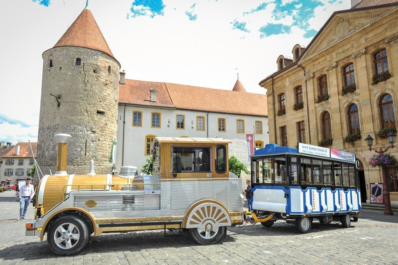The little train of Yverdon in front of the castle