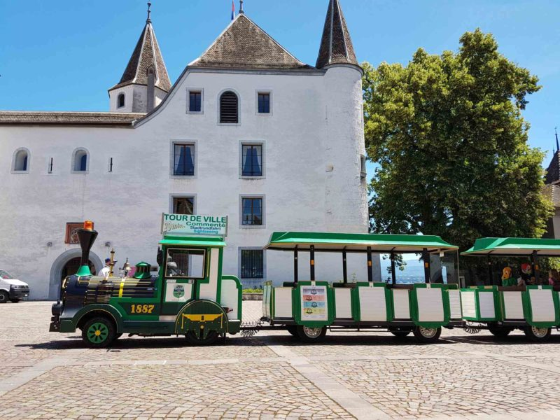 The little train from Nyon next to the castle.