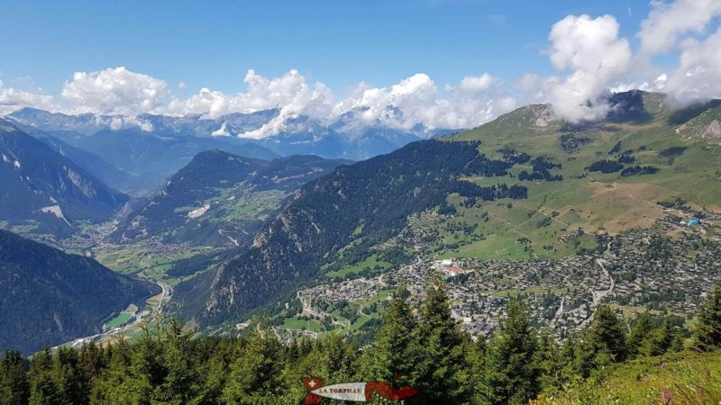West view from the Ruinettes. The village of Verbier on the right. On the left, the valley of Bagnes with the village of Sembrancher in the distance.