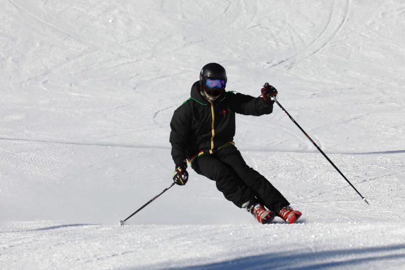 An alpine skier with a helmet