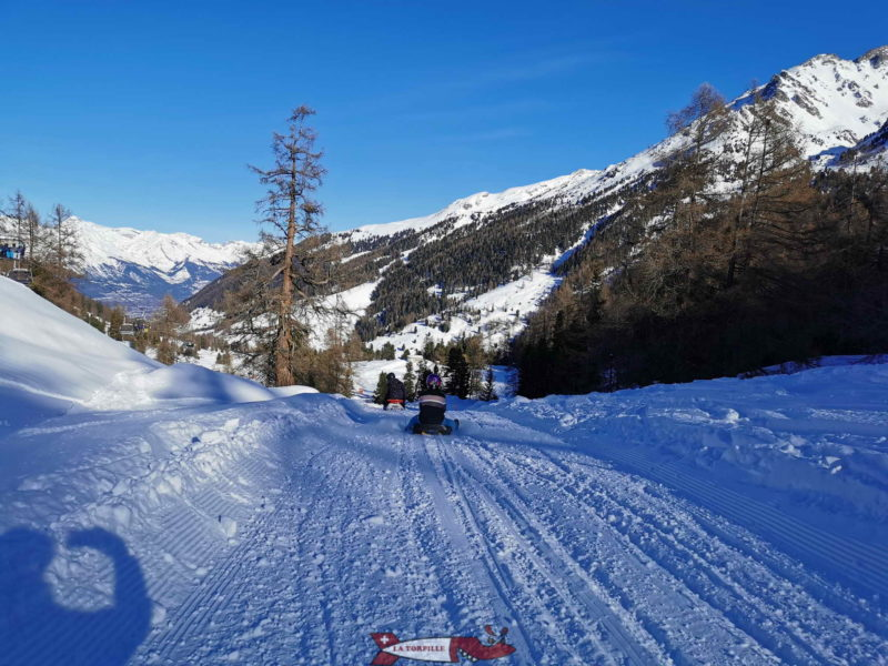 The Nendaz sled run with the valley of Nendaz and the Rhone valley in the background.