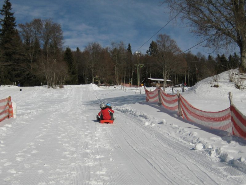 A bobsleigh being used to be pulled up to the top of the toboggan run.