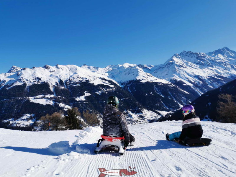 The toboggan run of Grimentz with the Val d'Anniviers in landscape.