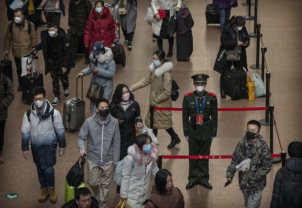 Une photo du New-York Times en Chine qui montre le port du masque intentif pour la population locale.
